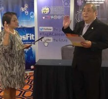 Dr. Florentino Doble being sworn into office by Labor Secretary Rosalinda Dimapilis-Baldoz.